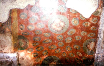 The paintings on the ceiling of ardha-mandapam