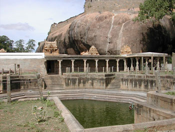 A view of the Vishnu Temple and the of pushkarani with the fort in the background, Thirumayam